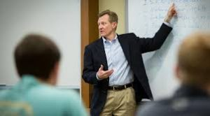 Jim Otteson teaching with white board